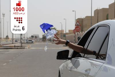 abu-dhabi-police-warns-against-throwing-masks-and-gloves-on-the-street-ePathram