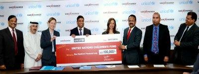 uae-exchange-donation-for-education-to-unicef-ePathram