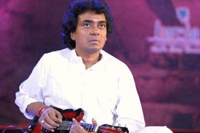 mandolin-player-u-sreenivas-ePathram