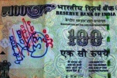 writing-on-currency-rupee-note-rbi-ePathram