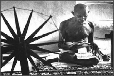 mahatma-gandhi-with-charkha-ePathram
