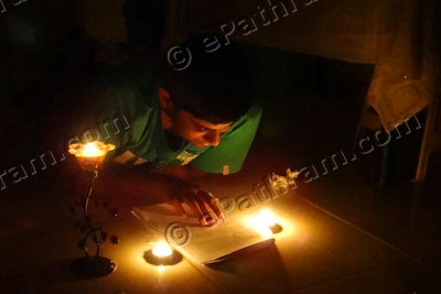 earth-hour-2013-dubai-student-studying-epathram