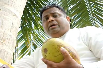 sri-lankan-minister-arundika-fernando-press-meet-in-coconut-tree-ePathram